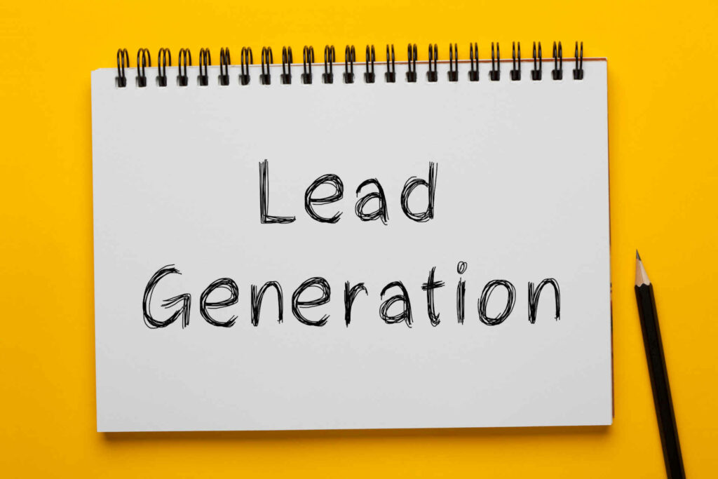 Lead Generation written on notepad with pencil on yellow background. Business concept.